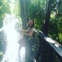 Me hugging a tree on the canopy bridge